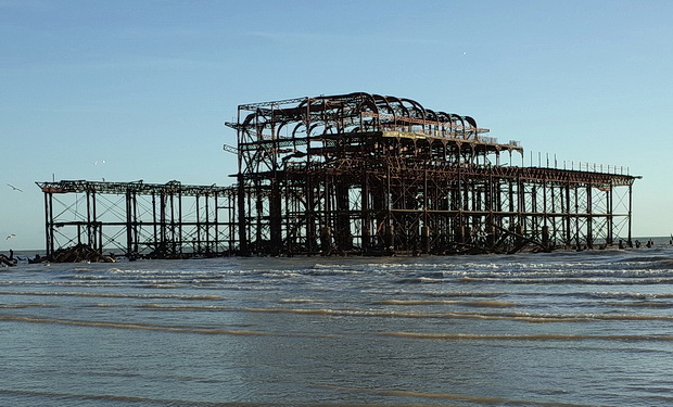Brighton's derelict West Pier in the winter sun and storms, East Sussex, England, February 2015