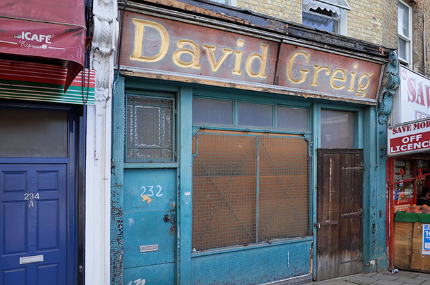 Wonderful old David Greig sign revealed at 232 Coldharbour Lane, Brixton