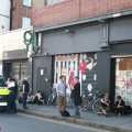 Police wait outside the Joy squatted queer centre on Coldharbour Lane, Brixton