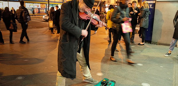 Seen busking outside Brixton tube station last night was this energetic violin player, looking to earn a few pennies from passers by.