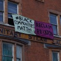 Reclaim Brixton banner appears on Walton Lodge luxury development