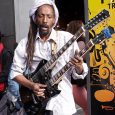 Seen rocking an unusual double neck 'axe' and playing along to backing tracks outside Brixton tube station is this familiar musician.