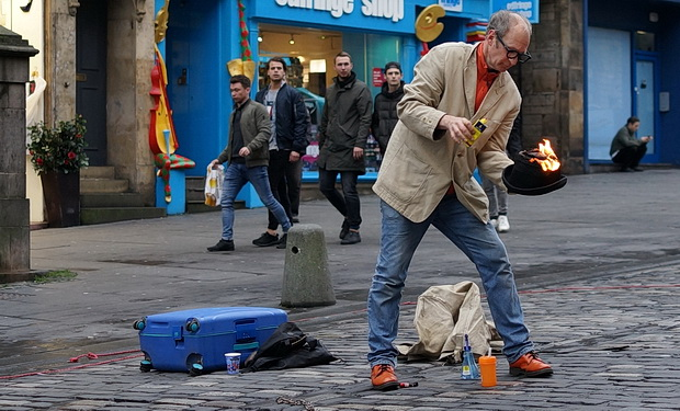 The burning hat flipping busker of Edinburgh - in photos