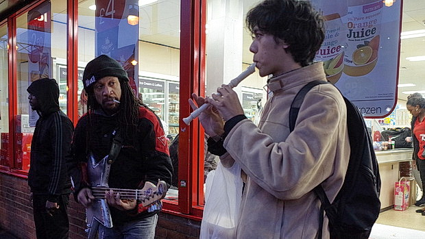 Brixton buskers: the funky bass player and the flautist